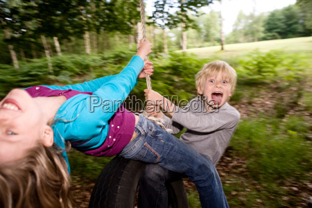 boy, and, girl, on, tire, swing - 18271086