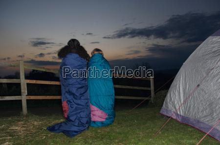 girl and boy in sleeping bags
