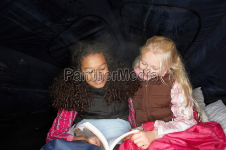 girls reading in tent