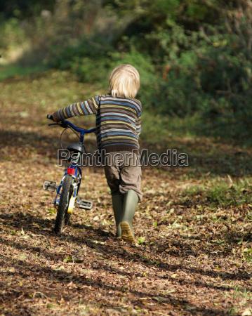 boy riding bike in countryside