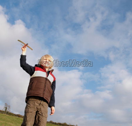 young boy with toy plane in