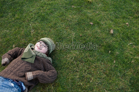 young boy on grass