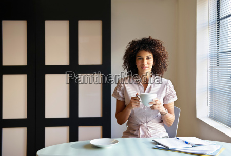 woman in cafe with paperwork