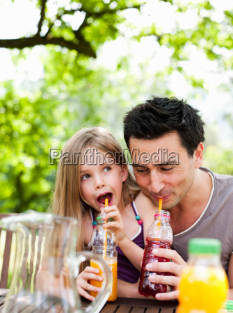 father and daughter drinking