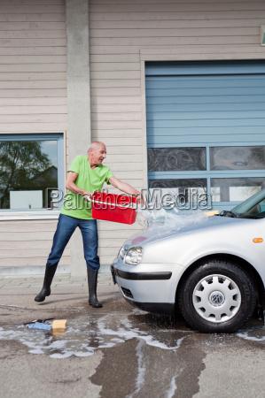 old man washing car