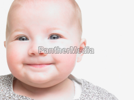 portrait of baby girl smiling