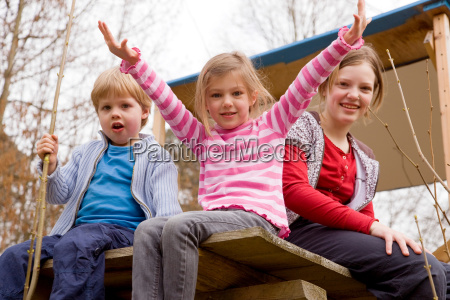 two girls and boy sitting in