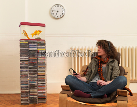 young woman in chair listening to