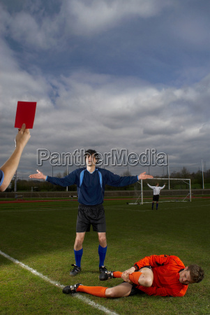 player being shown the red card