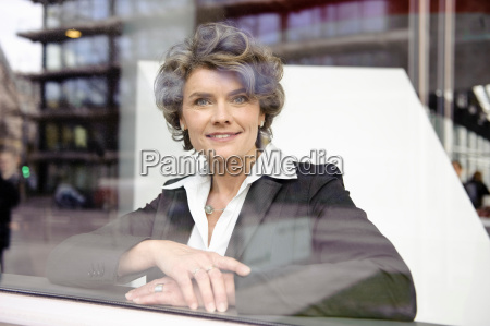 businesswoman looking out of the window