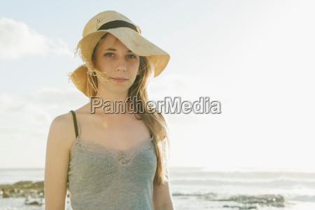 girl wearing old sun hat