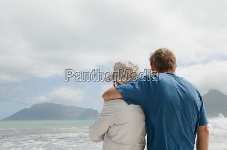 mature man hugging mature woman