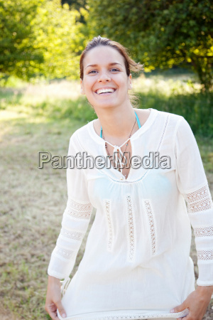 portrait, of, woman, smiling, in, countryside - 18274406