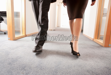 two people walking together in an