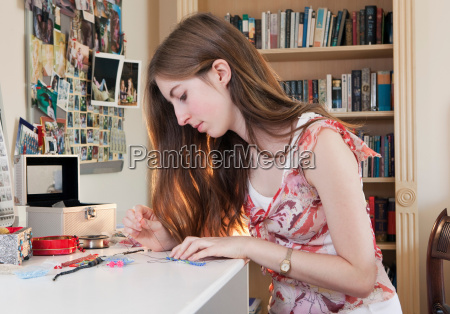 young woman making jewelry