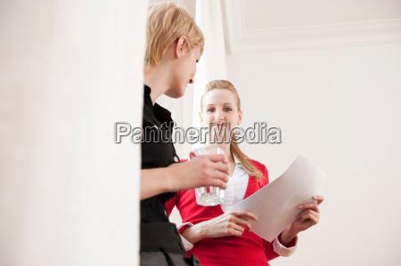 women having informal business meeting