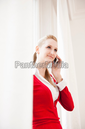 woman talking on telephone smiling