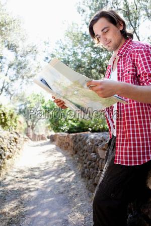 young man looking at map