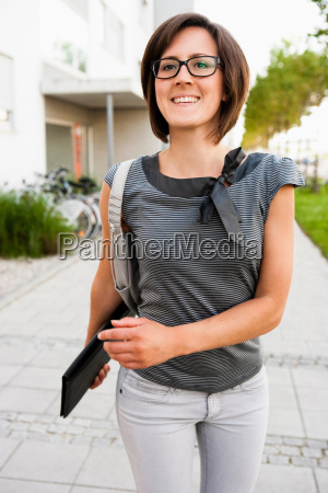 woman walking down street