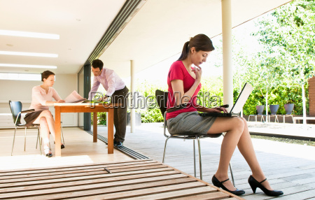3 business people in modern location