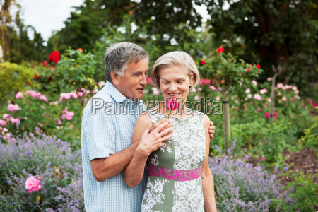 mature man gives woman a rose