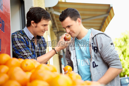 young people buying fruits and vegetable