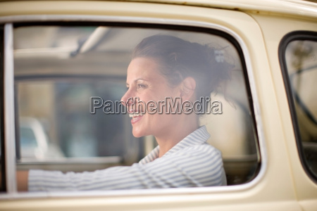 woman smiling in car