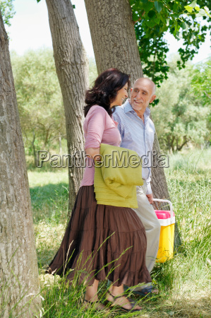 older couple strolling in forest
