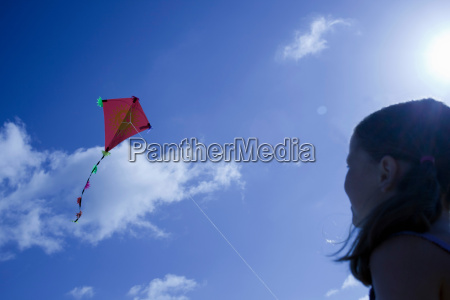 young girl playing with a kite