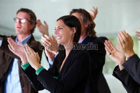 business team applauding smiling