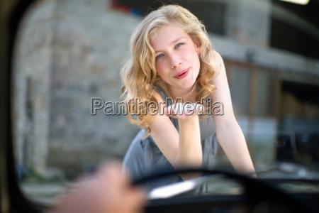 girl kissing man in in car