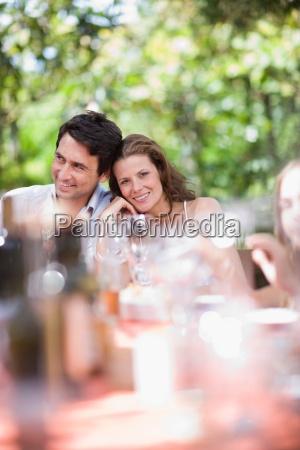 couple sitting on a celebratory table