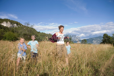 woman and boys running over a