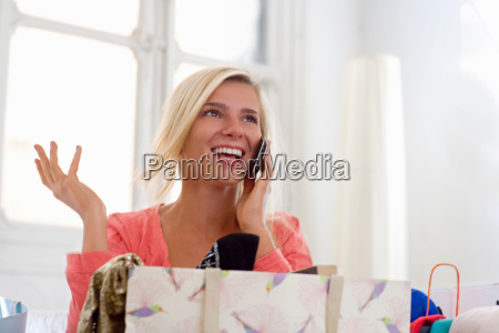 happy woman on phone with shopping