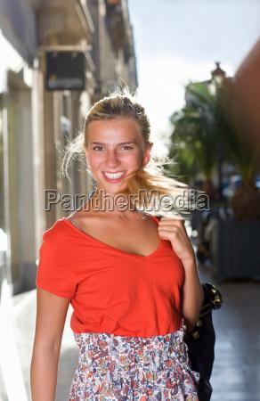 portrait happy woman in street with