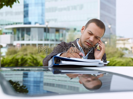 businessman with paperwork on top of
