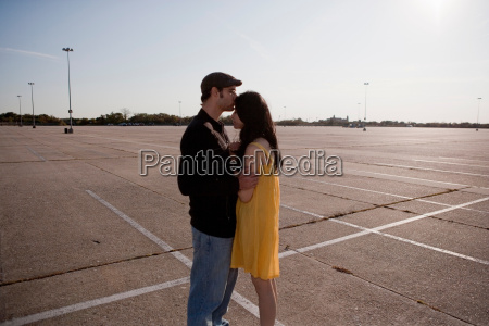 couple embracing in the parking lot