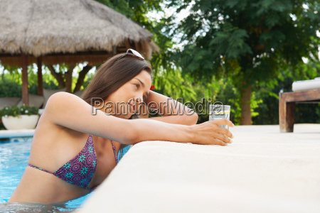 woman relaxing with drink in hotel