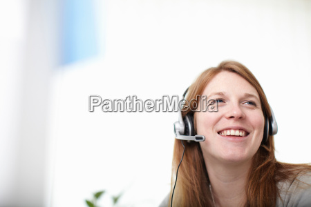 happy girl with headset next to