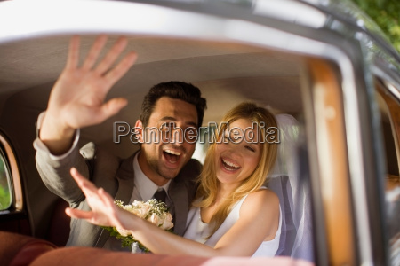 bridal couple in car