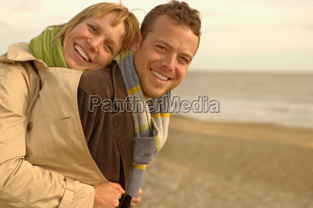 woman embracing man from behind on