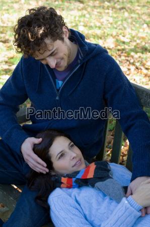 couple lying on bench