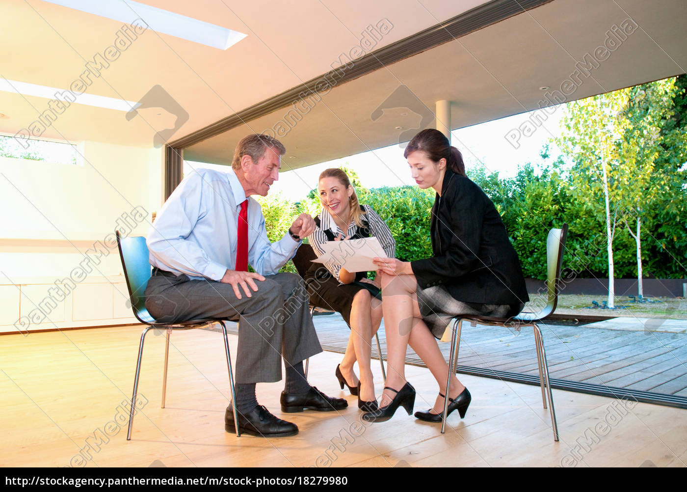 three, business, colleagues, with, papers - 18279980