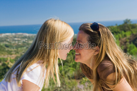 mother and daughter smiling face to