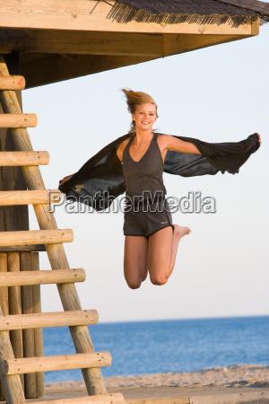 beautiful girl jumping beach