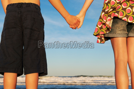 girl and boy holding hands on