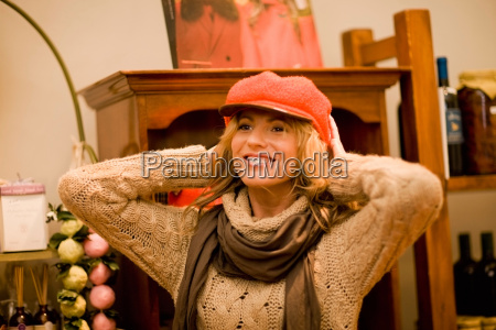 woman trying on a hat