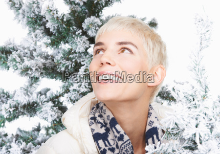 woman smiling snowy christmas trees
