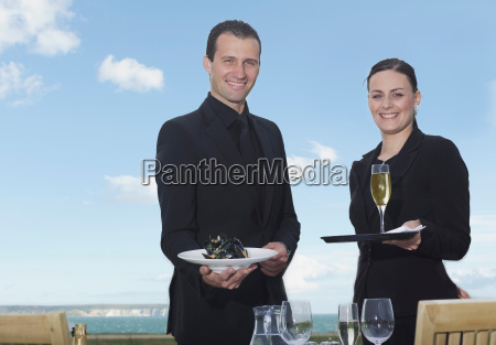 man and woman smiling to camera
