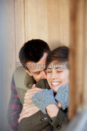couple cuddling in a hut in
